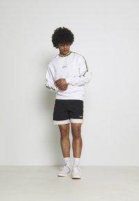 adidas Originals - TAPED UNISEX - Shorts - black - 1