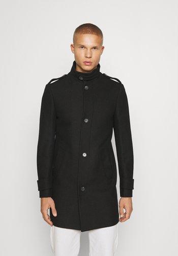 FUNNEL NECK COAT - Classic coat - black