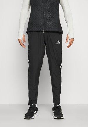 ASTRO PANT WIND - Spodnie treningowe - black