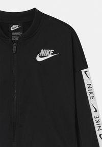 Nike Sportswear - SET - Tracksuit - black/white - 3