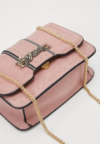 Topshop - PANTHER PIECE - Across body bag - pink