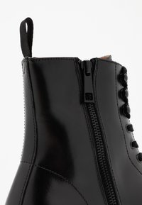 Steve Madden - KOMMBAT - Lace-up ankle boots - black - 5