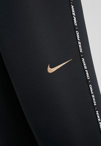 Nike Performance - Legginsy - black - 5