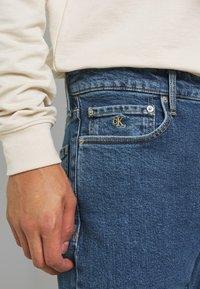 Calvin Klein Jeans - CKJ 026 SLIM - Jeans slim fit - mid blue - 5