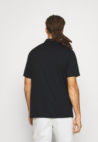 Nike Golf - DRY FIT ESSENTIAL SOLID - Sports shirt - black - 2