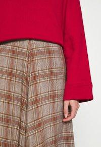 Rika - FLOW SKIRT - A-line skirt - brown/red - 6