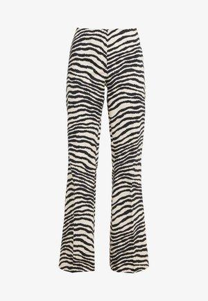 ERIKA - Trousers - dry desert