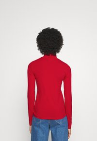 Tommy Hilfiger - ICON SLIM ROLL NECK - Long sleeved top - primary red - 2