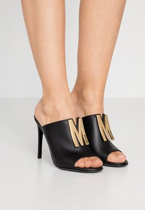 Heeled mules - nero
