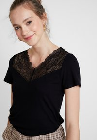 Vero Moda - VMANJA - Print T-shirt - black - 4