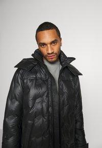 Diesel - W-RUSSELL-LONG-THERMO JACKET - Winter jacket - black - 5
