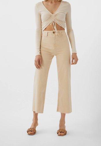 Flared Jeans - beige