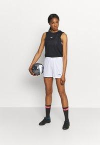Nike Performance - DRY ACADEMY SHORT - Sports shorts - white/black - 1