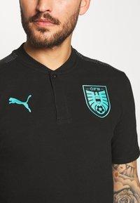 Puma - ÖSTERREICH ÖFB CASUAL - Polo shirt - black/blue turquoise - 4