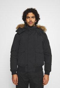 Calvin Klein Jeans - TRIMMED JACKET - Down jacket - black - 0
