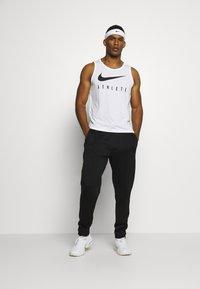 Nike Performance - TANK ATHLETE - Camiseta de deporte - white/black - 1