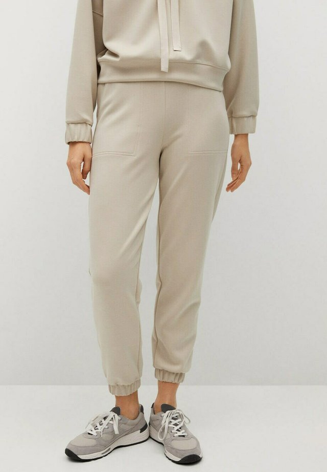 MONICA - Tracksuit bottoms - sable