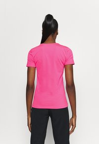 Nike Performance - ALL OVER - Camiseta básica - hyper pink/white - 2