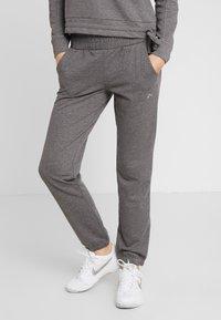 ONLY Play - ONPJULITTA LOOSE PANTS - Pantalones deportivos - medium grey melange - 0
