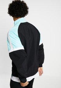 Puma - DIAMOND TRACK TOP - Training jacket - black - 2