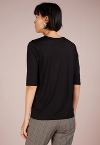Filippa K - TENCEL ELBOW SLEEVE - Jednoduché triko - black - 2