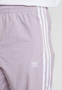 adidas Originals - LOCK UP ADICOLOR NYLON TRACK PANTS - Teplákové kalhoty - purple - 5