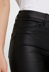 ONLY - ONLNEW ROYAL - Pantalones - black - 5