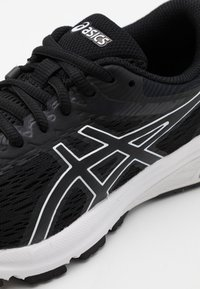ASICS - GT-800 - Stabilty running shoes - black/white - 5