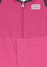 LEGO Wear - LWPUELO - Snowsuit - dark pink - 4