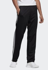 adidas Originals - FIREBIRD ADICOLOR TRACK PANTS - Tracksuit bottoms - black - 0