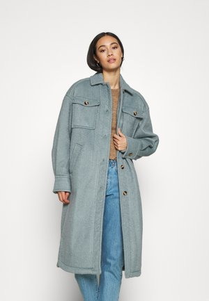 LONG TRUCKER COAT - Classic coat - blue denim