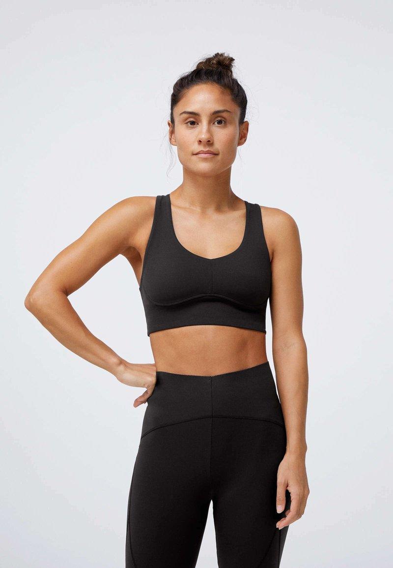 OYSHO - Medium support sports bra - black