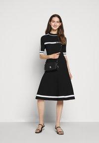 KARL LAGERFELD - DRESS LOGO - Pletené šaty - black/white - 1