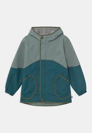 AARRE UNISEX - Waterproof jacket - trellis/bronze green