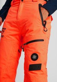 Superdry - PRO RACER RESCUE PANT - Täckbyxor - hazard orange - 3