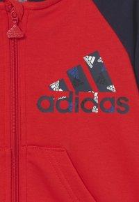 adidas Performance - LOGO SET UNISEX - Tracksuit - vivid red/white - 3