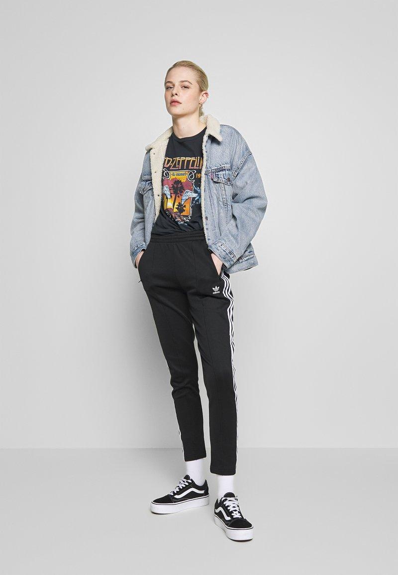 cotone Istituire preambolo  adidas Originals SUPERSTAR SUPER GIRL ADICOLOR TRACK PANTS - Pantaloni  sportivi - black/white/nero - Zalando.it