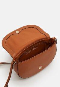 Calvin Klein - SADDLE BAG - Across body bag - brown - 2