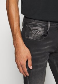 Replay - ANBASS HYPERFLEX BIO - Slim fit jeans - black - 4