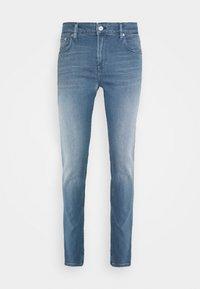 SKIM BREAKOUT - Slim fit jeans - break out