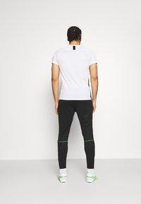Nike Performance - ACADEMY 21 PANT - Tracksuit bottoms - black/green strike - 2