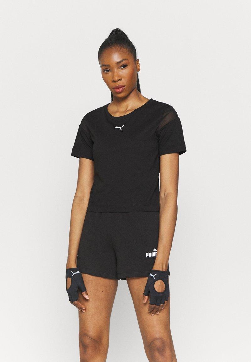 Puma - PAMELA REIF X PUM TEE BACK CUTOUT - Print T-shirt - black