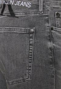 Calvin Klein Jeans - SLIM FIT - Slim fit jeans - denim grey - 7