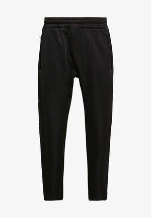 LUX PANTS - Teplákové kalhoty - black