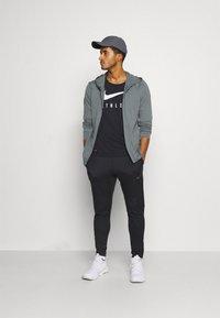 Nike Performance - Training jacket - smoke grey/iron grey - 1