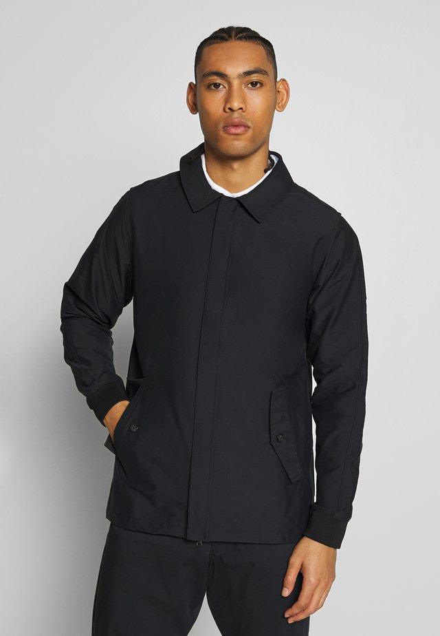 REPEL PLAYER - Waterproof jacket - black