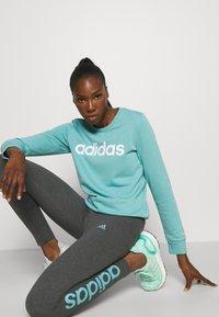 adidas Performance - LOUNGEWEAR ESSENTIALS HIGH-WAISTED LOGO LEGGINGS - Tights - dark grey heather/mint ton - 3