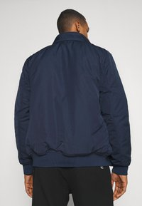 Tommy Jeans - TECH BOMBER UNISEX - Winter jacket - twilight navy - 4