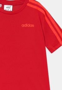 adidas Performance - SET UNISEX - Sports shorts - scarlet/solar red/black - 3