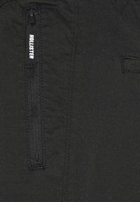 Hollister Co. - JOGGER TAPER - Kangashousut - black - 4